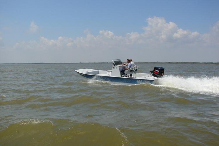 l_runningshotofredfishlineofmajekboats
